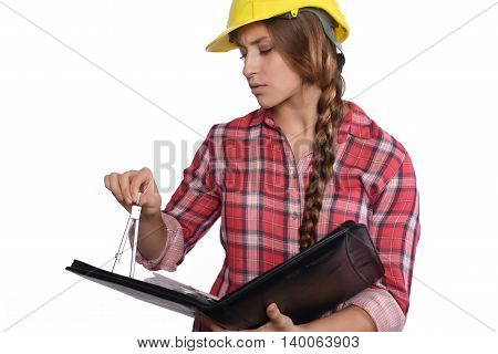 Portrait of beautiful woman construction worker reading blueprints and with a compass. Isolated white background.