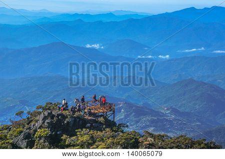 Mount Kinabalu,Ranau,Malaysia-March 13.2016:Group of climber enjoying the view top of the Ranau and Kundasang town from viewpoint Mountain Kinabalu.