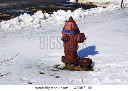 JOLIET, ILLINOIS / UNITED STATES - NOVEMBER 24, 2015: A red Glow fire hydrant in the snow after a November snowstorm in Joliet.