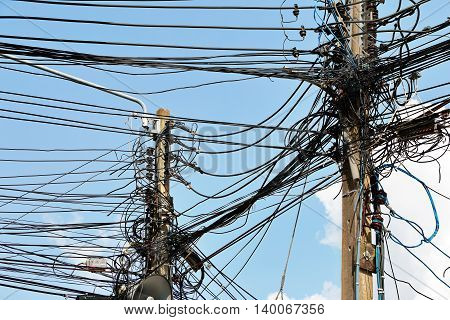 Electronic and cable line in city chaotic wire on pole with sky background
