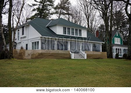 WEQUENTONSING, MICHIGAN / UNITED STATES - DECEMBER 23, 2015: A white home on Beach Drive in Wequetonsing, Michigan.