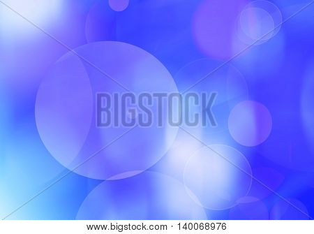 Blue light and circles abstract blur background holiday card.