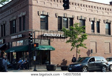 LA GRANGE, ILLINOIS / UNITED STATES - MAY 21, 2016: One may drink Starbucks Coffee in downtown La Grange, Illinois.