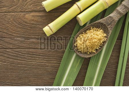 granulated brown sugar produced from sugar cane top view. Agriculture Industry concept.
