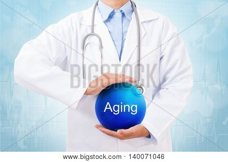 Doctor holding blue crystal ball with aging sign on medical background.