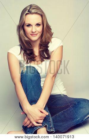 Beautiful young blond woman sitting