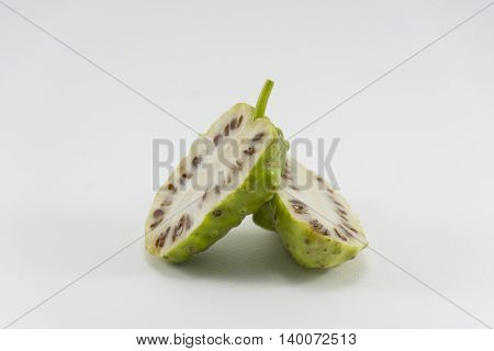Noni and noni slice isolated on white background.Fruit  for health and herb for healthy care.