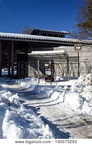Electric vehicle charging station in snow, Kawaguchiko Japan