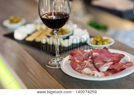High angle view of meat and wineglass on table at restaurant