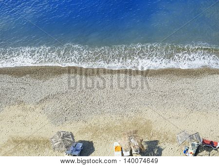 Beautiful beach and tropical turquoise blue sea from above