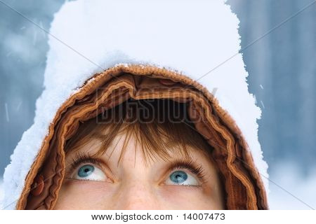 Young woman's face part with snow heap on head