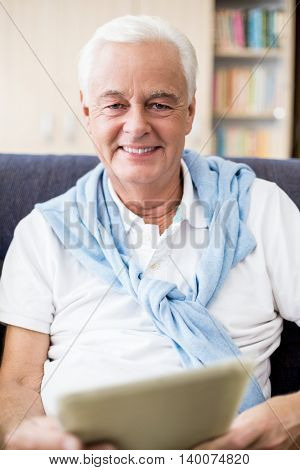 Senior using a tablet in a retirement home