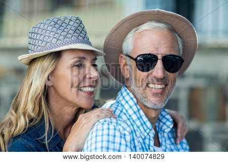 Close-up of smiling mature couple in city