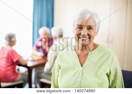 Senior woman standing in a retirement home