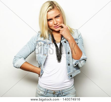 portrait of cheerful blonde hipster girl