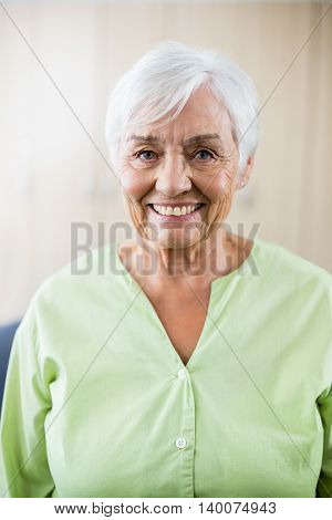 Senior woman smiling at camera in a retirement home
