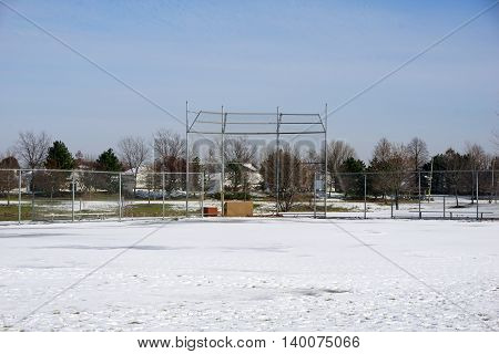 A baseball field in Joliet, Illinois is covered with snow after a November snow storm.
