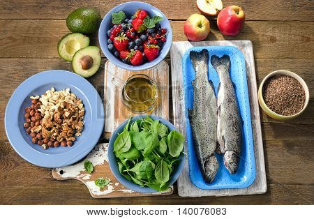 Foods For Healthy Heart On A Wooden Table.