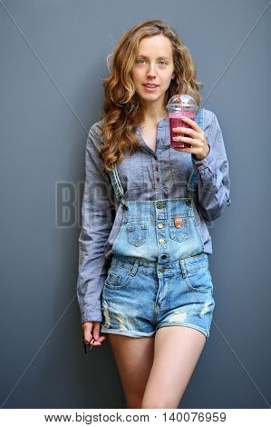 Blonde Woman Hipster With A Smoothie In Disposable Cup. Healthy Lifestyle