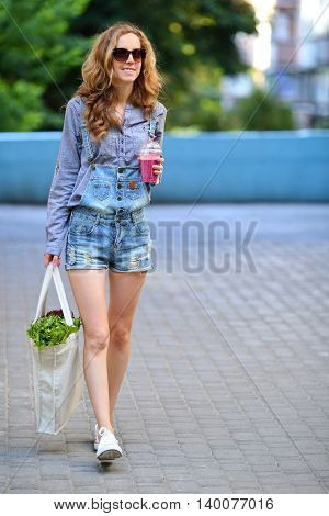 Sexy Woman Hipster With Healthy Food And Beverage In Their Hands On A City Street