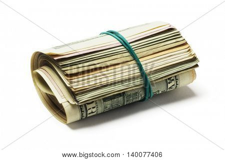 Rolled up of Various Old US Dollar Bills Lying on White Background