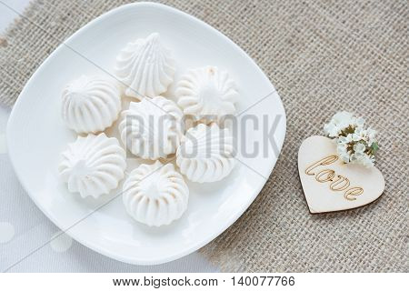 Meringue - the Traditional French dessert on a light background close up the top view