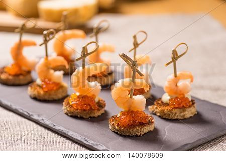 Shrimp Appetizer served on toasted bread with golden Caviar