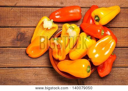 Small bell peppers in red and orange