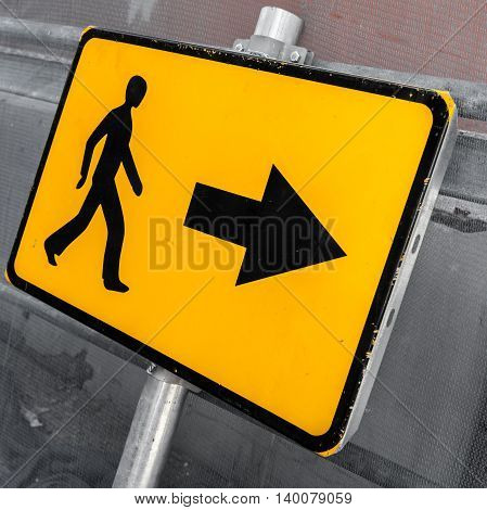 Pedestrians Bypass Direction. Yellow Road Sign