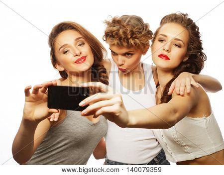 girls best friends taking selfie