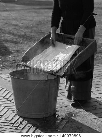 Woman Does The Laundry In An Old Vat
