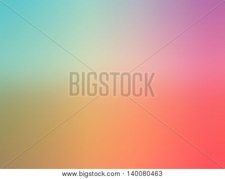 Abstract gradient rainbow red purple blue yellow colored blurred background.