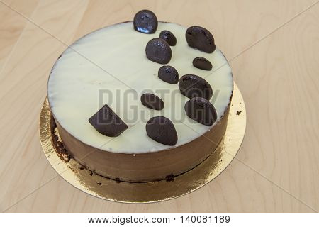 Decorated chocolate mouse cake on a table