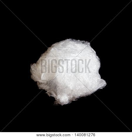 White crumpled plastic ball on a black background