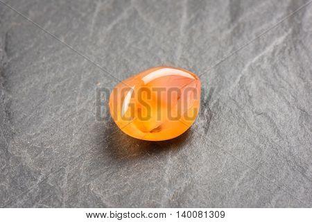 precious gemstone against background Carnelian, sacred gemstone