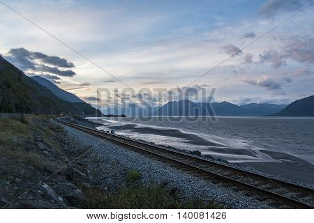 sunset on railway from anchorage to seward