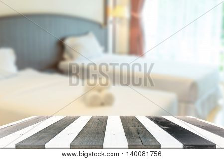 Wood Table And Blurry Bed Room In Background