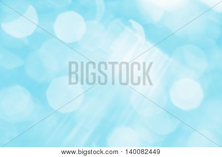 Abstract blue background with white rays and sun glare