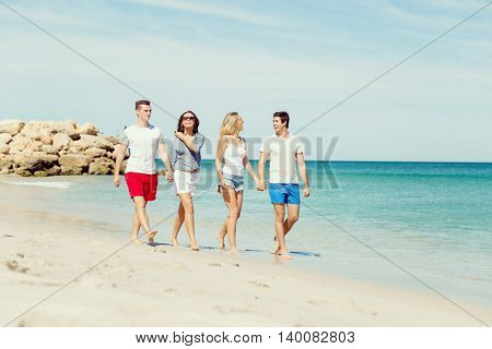 Company of young people on the beach