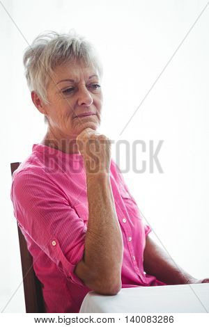 Portrait of a worried senior woman with her elbow on the table