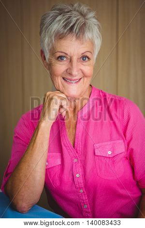 Portrait of a smiling retired woman looking at the camera