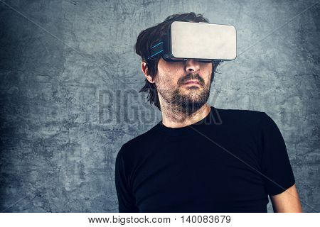 Adult Man wearing virtual reality goggles for 3d VR multimedia content modern futuristic technology gadget