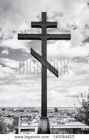 Big christian cross in Slavin memorial monument and military cemetery in Bratislava the capital of Slovak republic. Black and white photo. Religious object. Cultural heritage. Architectural theme.