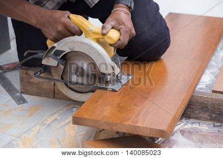 Carpenter Use Electric Saw To Sawing Wood
