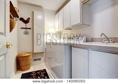 White Old Style Laundry Room Interior With Tile Floor.