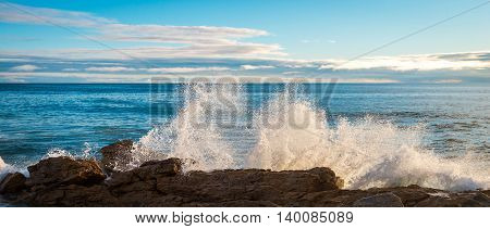 Waves crashing into the rocks at sunset South Australian shores