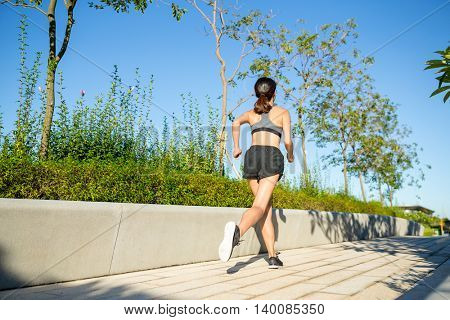 Asian Woman running in a park