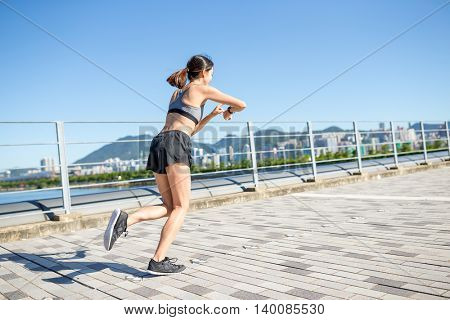 Young Woman run in a city