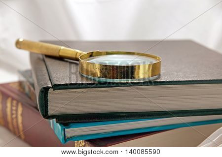 books and magnifying glass background retro loupe