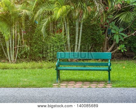 A green wood bench in the park